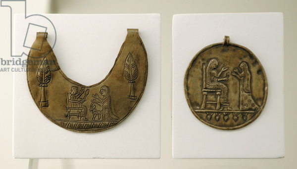 Urartu civilization. Pectoral and gold medallion decorated with reliefs. The pectoral depicts the image of god Haldi on the throne and his wife Arubani. The madaillon, a seated goddess. From Tushpa or Toprakkale. 7th century B.C.
