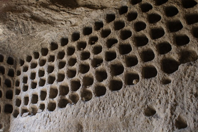 Rows of pigeon holes of a dovecote inside a rectangular chamber in the Igadzor valley cave-complex.